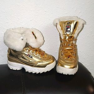 Gold Fila Disruptor girl's boots